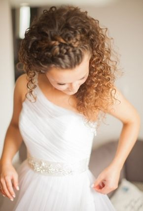 Top Braids: If you're a bride with curly hair, you might think that half-up hairstyles would look too messy, or make your hair look out of balance for your wedding. But they really don't, so long as you can harness all that volume! Braids on top of your head are a great way to tame those tresses on your wedding day.