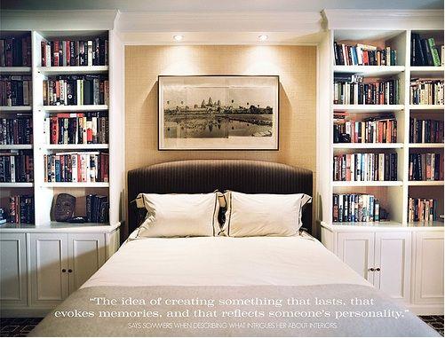 Bookshelves surrounding headboard with spotlights
