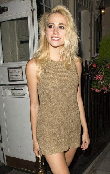 Pixie Lott is all smiles as she leaves the Haymarket Theater after performing in 'Breakfast at Tiffany's in London.