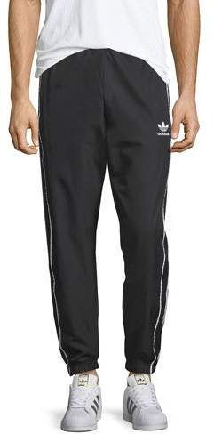 fd628b7b86f7e #Adidas #Men's Authentic #Active #Wind #Pants! Adidas wind active pants  with signature 3-stripes at sides. Side slip pockets. Pull on style. Banded  cuff.
