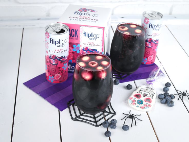 "Bring out the boo's and make Eyeball Punch for Halloween. (3 Servings) Pop a blueberry into 18 lychees cavities. Add to the freezer for 1 hour (keep the lychee juice from the can!) Grab a bowl or pitcher and stir 1/2 cup concentrate black currant juice (unsweetened), 1/2 cup syrup from the lychee can, 1 can flipflop Fizzy Pink Moscato, and 1.5 oz Grand Marnier. Remove ""eyeballs"" from freezer and add to the mixture. Top 3 cups lemon lime seltzer and stir lightly. Serve in highball glasses…"