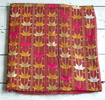 Punjabi Phulkari, hand embroidered, given to daughters by their moms at their weddings ;) i display mine proudly!