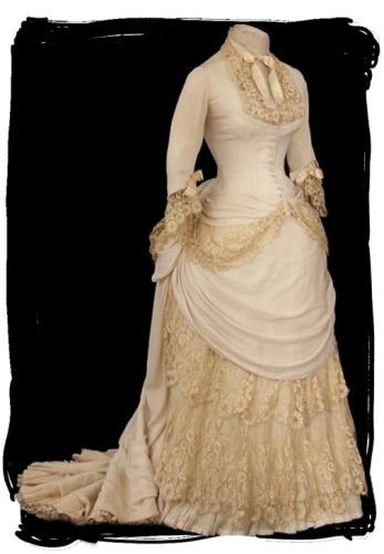 Bustle dress with lace underlay
