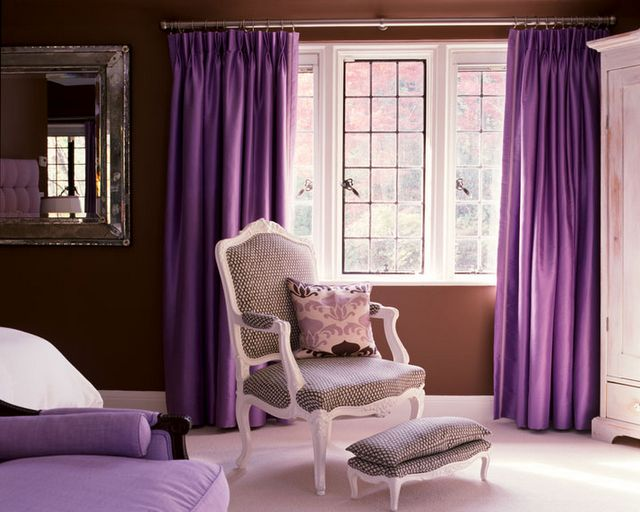 I don't like the curtains (wrong color purple for me), but I really like that cream and purple chair and footstool.