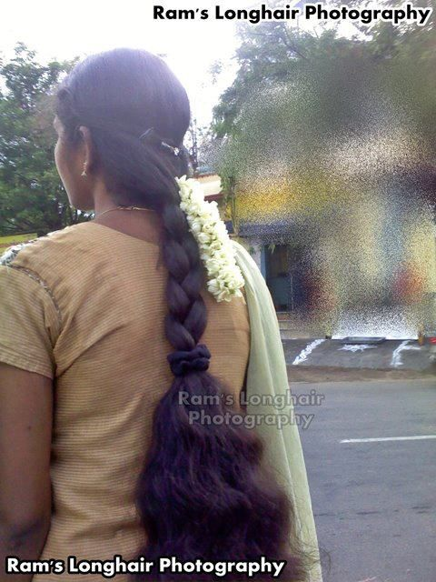 Tamil Nadu college girl with long hair braid consisting of three strings: they are a symbol for faith, hope and love. All three together in a braid symbolise the mental strength of the woman.