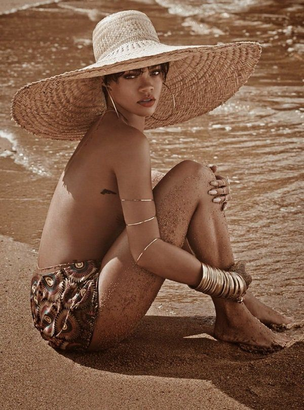 """Rihanna Loads Up on Gold Jewelry for Topless """"Vogue"""" Shoot"""