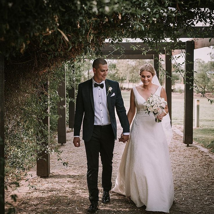 Greg and Natt, off for some post ceremony personal time after their wedding | Photography by Cam Grove | Flowers by Blooms on Bridge
