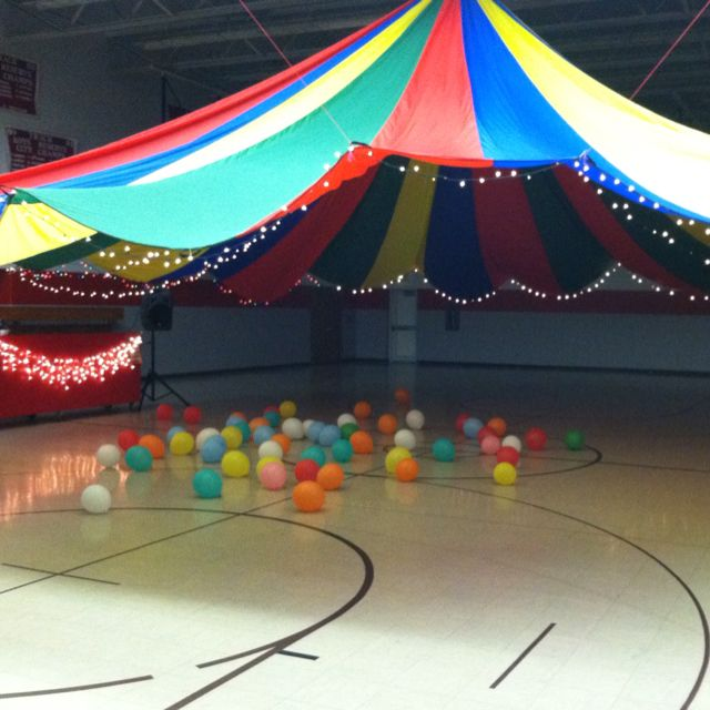 Middle school dance decorating idea.... Parachute hung from ceiling & trimmed with Christmas lights!