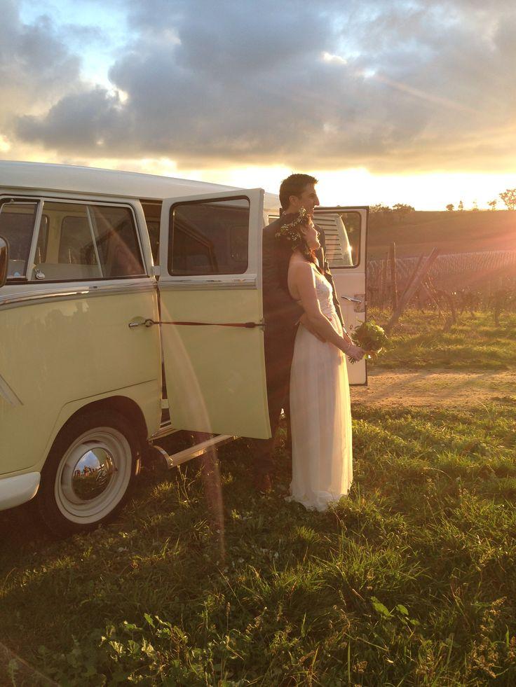 Sunset photo of bride and groom with Kombi wedding vehicle