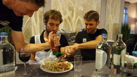 Team mates helping Laurens ten Dam out by cutting his dinner and squeezing ketchup after he dislocated his shoulder during a horrific fall during stage 3 of #TDF2015
