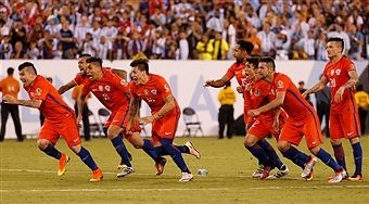 Players of Chile celebrate after Francisco Silva (not in frame) scored the winning penalty during the championship match between Argentina and Chile at MetLife Stadium as part of Copa America Centenario US 2016 on June 26, 2016 in East Rutherford, New Jersey, US.
