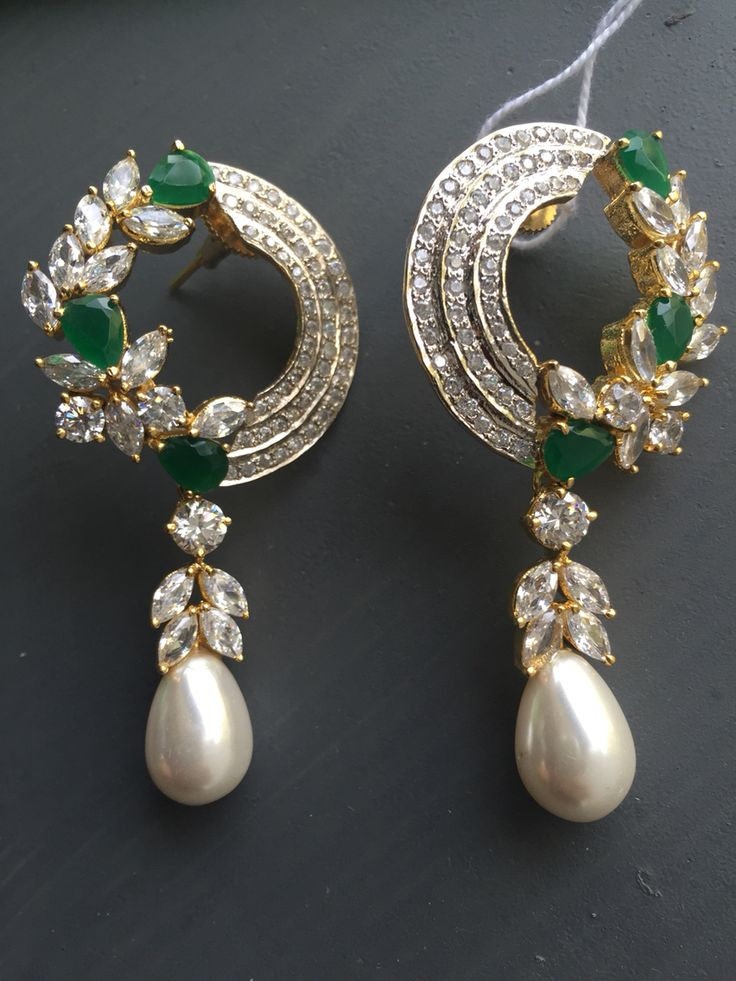 Half stone pearl earrings @Ra art .prices contact 919920510372