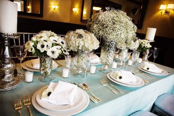 Aqua linens with white and silver table arrangements