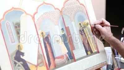 Iconography - man paints orthodox icon.