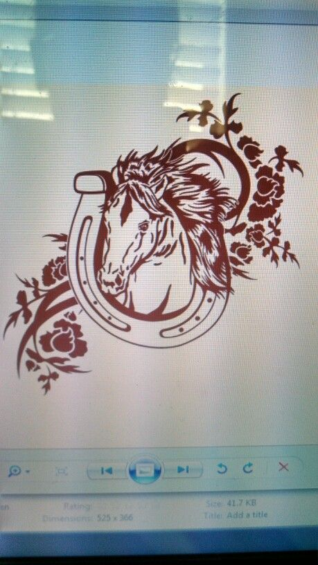 Horse in horseshoe with flower design