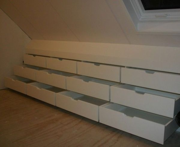 Bank of drawers built into the eaves by kelly.meli