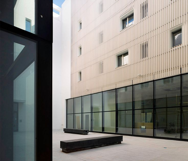 courtyard with a public space #elevation #residence #commercial #brisesoleil #banch #suspended #wall #facade #light #glasswall
