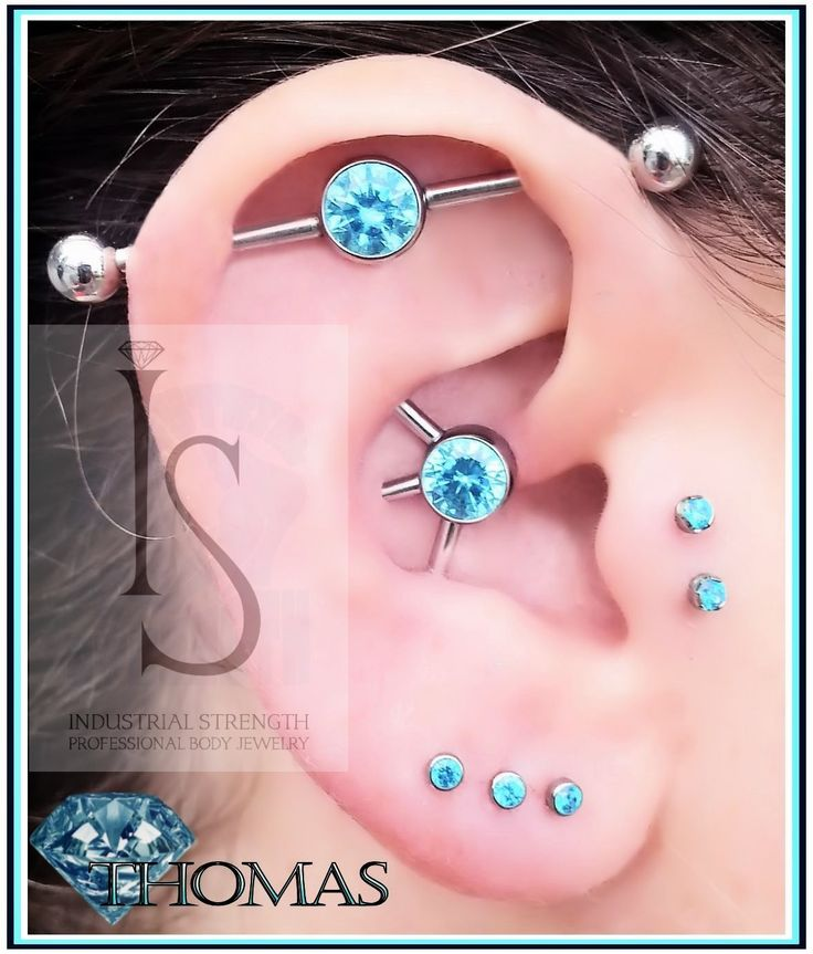 ear project including multiple point industrial in the conch, double tragus piercing, standard industrial piercing and lobe trio. All mint green gems from Industrial Strength :)