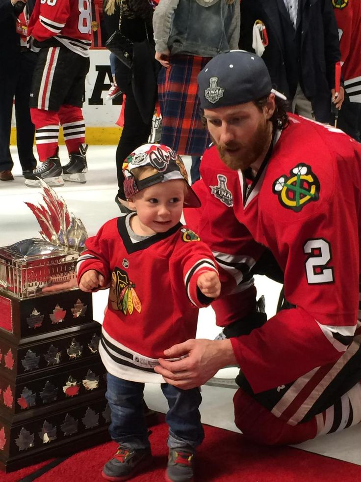 Duncan Keith and his little son, Colton, who was a newborn when the Blackhawks won the Stanley Cup in 2013. Cute!