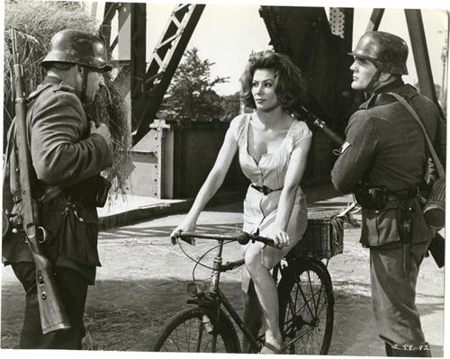 Irina Demick rides a bike. Uh-oh, Nazis.    movie, The Longest Day