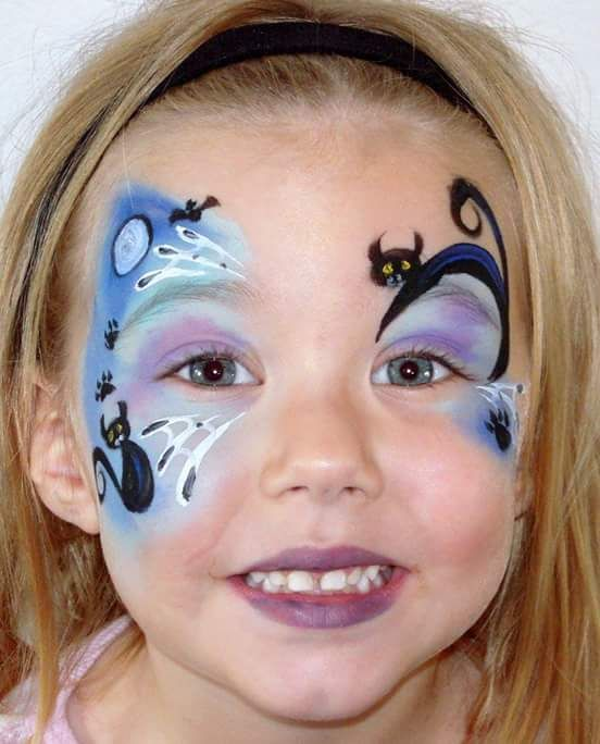 I like the arching cat over the eyebrow. #halloween #facepainting