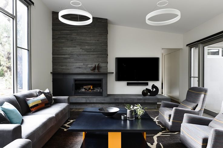 Camilla Molders Design - tv next to fireplace with two chandeliers