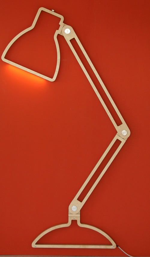 "Nepa Lamp by Giles Godwin-Brown. A two-dimensional ""lamp silhouette"" that stands six feet. It's wall-mounted and equipped with friction hinges to allow the piece to pivot away from the wall. Constructed of birch plywood and stainless steel with some aluminum details, it utilizes high-powered LED lighting."
