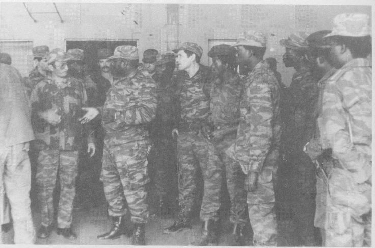 "A Military Meeting is conducted after The Battle of Cangamba of August 1983. Angola's Minister of Defense Pedro Maria Tonya ""Pedale"" is present, along with Cuban General Leopoldo Cintras Frias, The overall Commander of The Cuban Army in Angola. Soviet officers are also present."