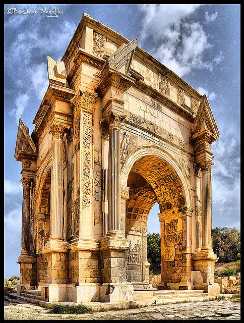 The Arch of Septimius Severus in the ancient city of Leptis Magna - Libya - early 3rd century AD - note the broken pediment - this is highly innovative and rare in Roman architecture of the period