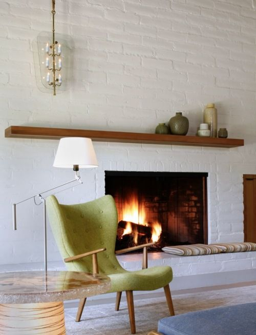 mantle, white brick fireplace, chair