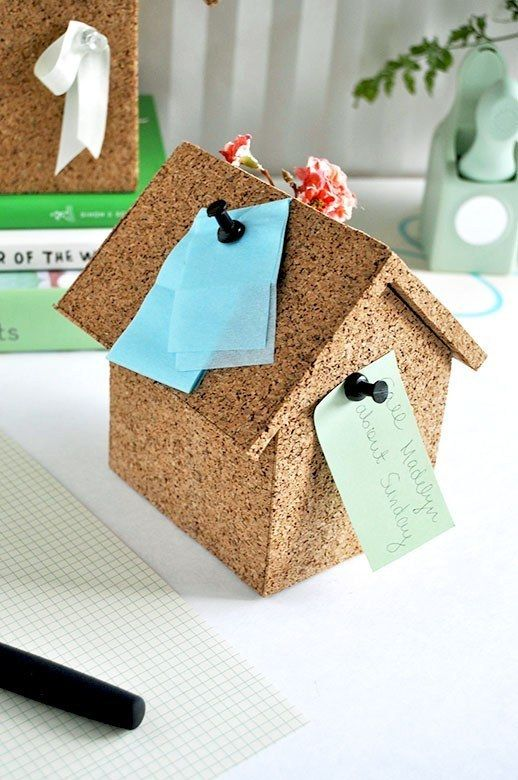 Use plain cork board to create an adorable note house.