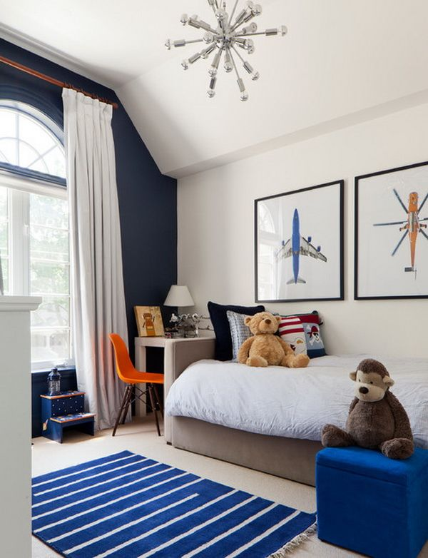 Today we want to share a bunch of wonderful boys bedroom ideas and pictures with you. Most of the rooms have a distinctive boy design element such as a toy car, a football, a gaming device and so on. All of them are bright and set active and creative mood.