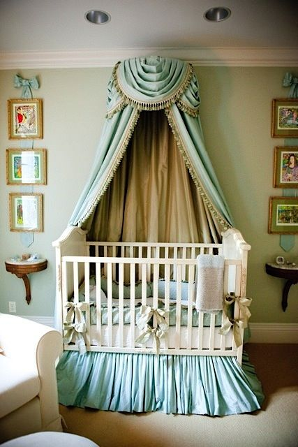 Traditional crib bedding with ruffled skirt.  The canopy and the artwork hung with matching ribbon add lots of elegance to this nursery.