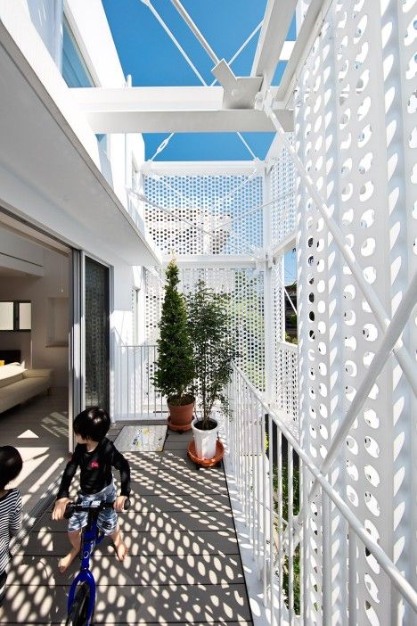 Housing development in Tokyo with perforated steel facades
