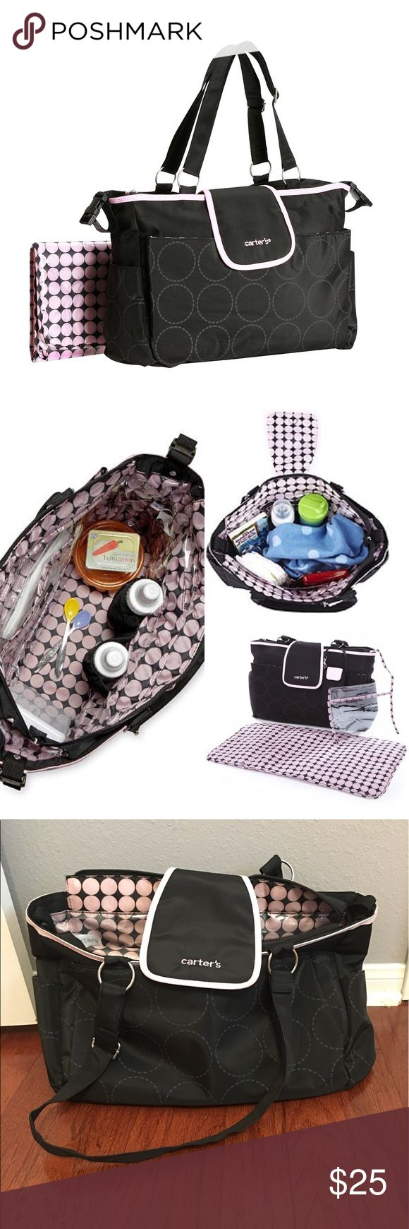 Carter's Diaper Bag Only used once!! Carter's Tonal Dot Diaper Bag in Black and Pink features a spacious main compartment which includes mesh and zippered pockets and a built in bottle holder. This Carter's diaper bag makes cleaning a cinch with easy to wipe interior lining. The bag includes accessory pouch, changing pad, and stroller loops.  features Accessory pouch included Changing pad included Six interior pockets Four exterior pockets Carter's Bags Baby Bags
