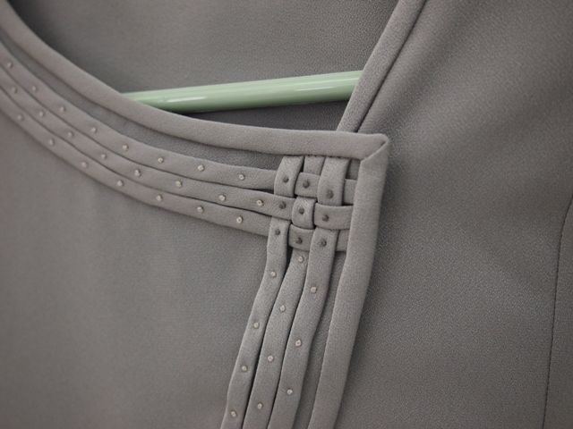 Taupe top with woven fabric trim; sewing inspiration; fashion design detail