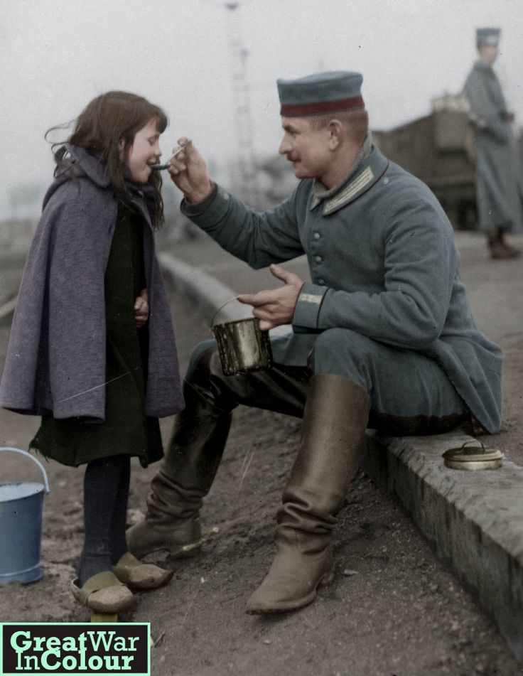 A German soldier shares his lunch with a young girl.Original image source: Nationaal Archief