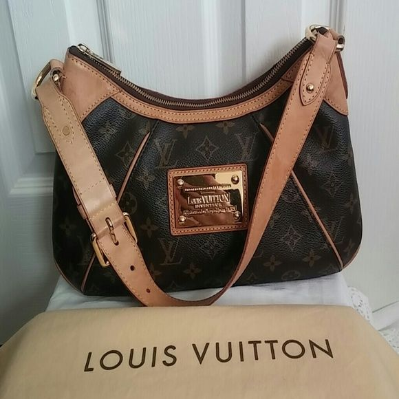 Authentic Louis Vuiiton handbag LV Thames PM Classic Monogram Print Date code.  MI3089 EUC, some water spots on handle as shown in pic 2 but inside is like new. Gets better with age.  Buckle detail on shoulder strap.  Reasonable offers please Louis Vuitton Bags Shoulder Bags