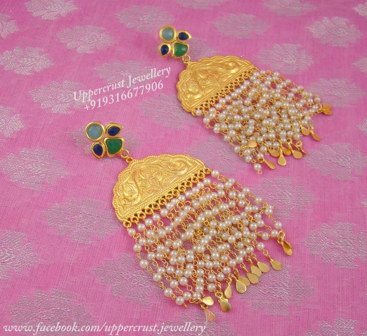 cascading pearl gold plated peacock motif earrings