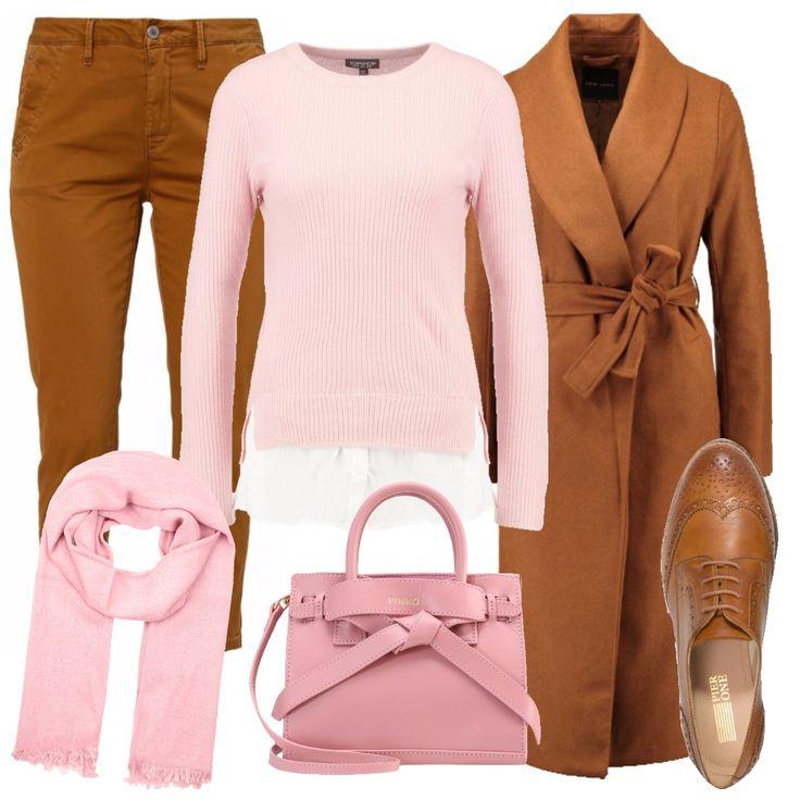 Un accostamento di colori non usuale, ma bello e originale. Pantalone chino color cammello, da portare, se il freddo lo permette, con la caviglia leggermente scoperta. Ai piedi delle splendide derby in cuoio, leggermente lavorate. Sopra un maglioncino rosa composto, con finta camicia bianca che sbuca. Il cappotto, del colore dei pantaloni, è il vero affare dell'outfit, su Zalando. Gli accessori in rosa invece: morbida sciarpa in misto lana e una borsa a mano, con tracolla, firmata Pinko.