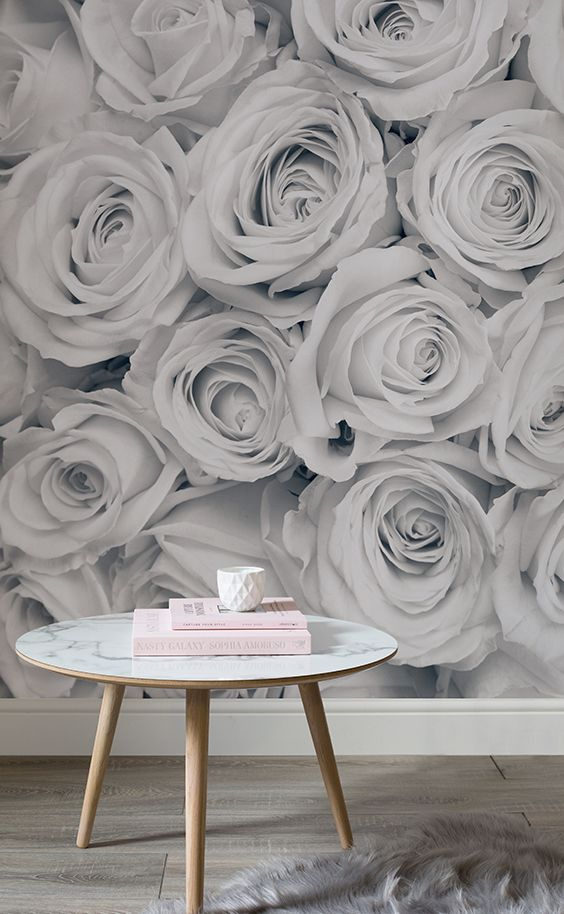Sophisticated and girly. This floral wallpaper design combines silvery greys and larger than life roses to give your home a totally unique look. Perfect for bedroom and living room spaces.