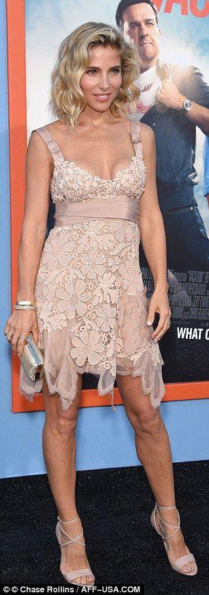 So pretty: Elsa, 39, wowed in a blush lace mini dress with ribbon belt...