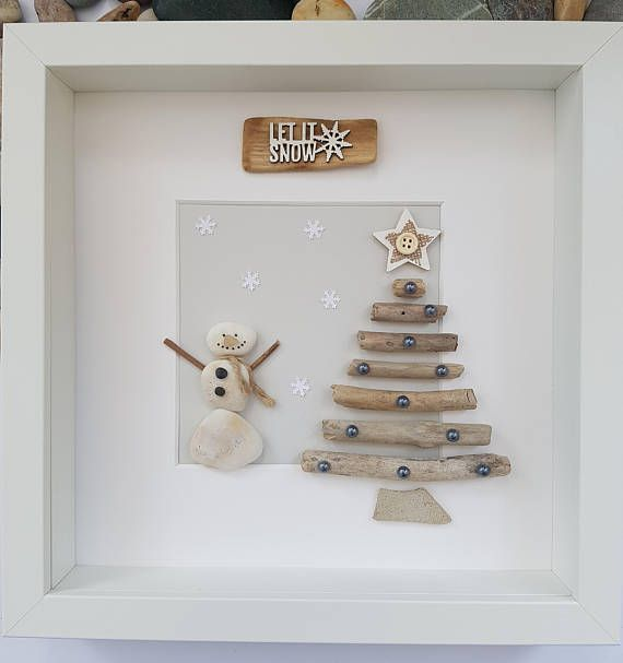 A beautiful and unique handmade beach pebble picture of snowman next to driftwood Christmas tree with driftwood sign let it snow. This picture is a lovely Christmas decoration and would make a perfect gift. The picture is made using pebbles, driftwood, jute twine and card. All materials are carefully placed and fixed with high strength glue onto grey card. I can include printed quotes or personalised messages onto picture. If you require personalisation, before sending you the picture I will…