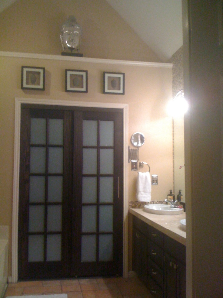 the doors use to be sliding mirror doors,i bought pine interior french doors and put them on the sliding track and painted blk