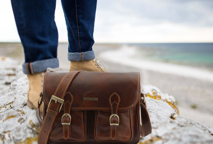 Made in Premium Italian Leather. A classics but modern appeal.  Designed with two classic magnetic closures to front pockets, zip pocket on the rear, mobile phone holder, an adjustable shoulder strap and luxuriously lined in cotton and loaded with space it is perfect for work, weekends or travel.