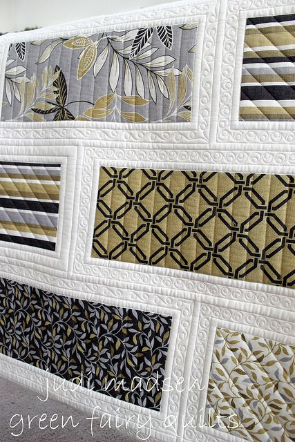 green fairy quilts.   Love the quilting!