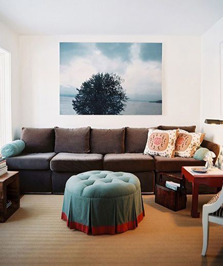 An extra-large sofa can mean plenty of room to stretch out, but it can also engulf a room. The trick is to anchor an oversized piece of furniture against a wall and use other voluminous accessories (a jumbo print or a king-sized ottoman) for balance.