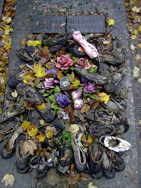 The grave of Marie Taglioni, covered in ballet-slippers, in Cimetière Montmartre, Paris. Marie Taglioni was the daughter of the Italian choreographer Filippo Taglioni. Her slender figure lived up to the romantic idea of a perfect body and she would become the leading ballerina of the romantic era.