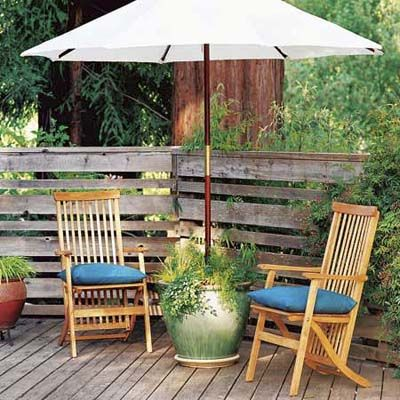 Support a patio umbrella in a flower-filled pot borrowed from the garden as a crafty alternative to a plain metal stand. Cut 2-inch ABS pipe to the height of the pot. Center it inside and anchor in place with a layer of gravel on the bottom, quick-setting concrete in the middle, and soil on top. Plant the pot with flowers, and slide the umbrella into the pipe sleeve. 