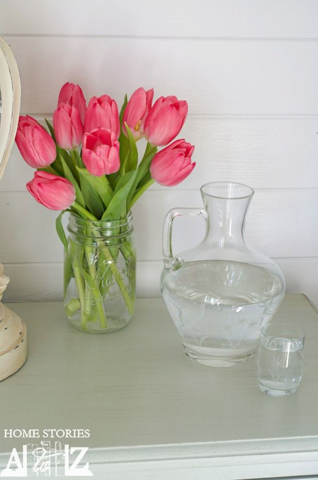 tips for hosting guests - writer suggests that tulips are a pretty safe choice. We do silk flowers, as 2 of our 3 kids have allergies.